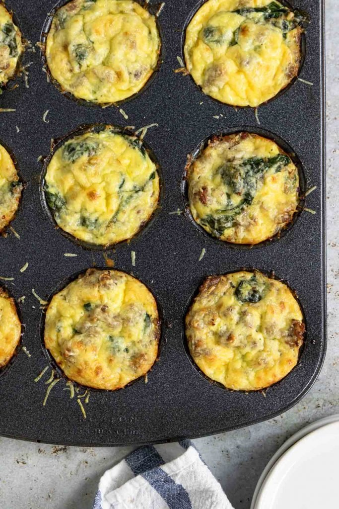 cooked sausage egg cups in a muffin tin