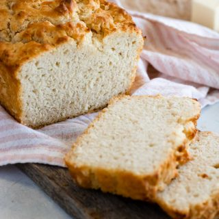 A loaf of easy Beer Bread, sliced into 2 slices