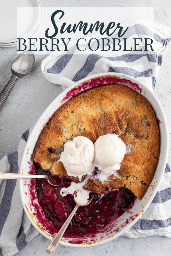Summer Berry Cobbler in a white baking dish topped with ice cream- pin image