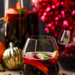 winter red sangria with holiday decor in the background