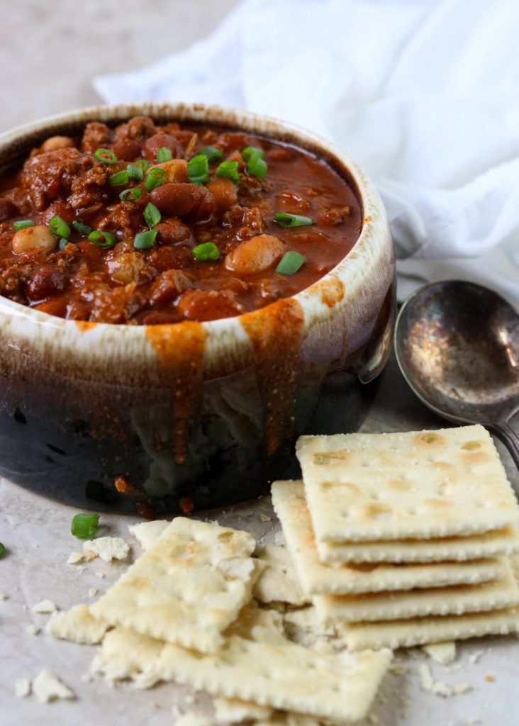 chili in a bowl with crackers