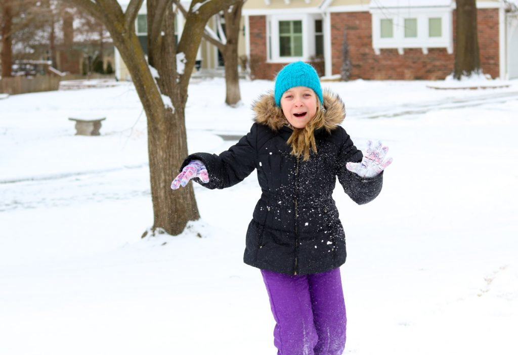 Maddie playing in the snow