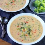 a bowl of broccoli cheese soup