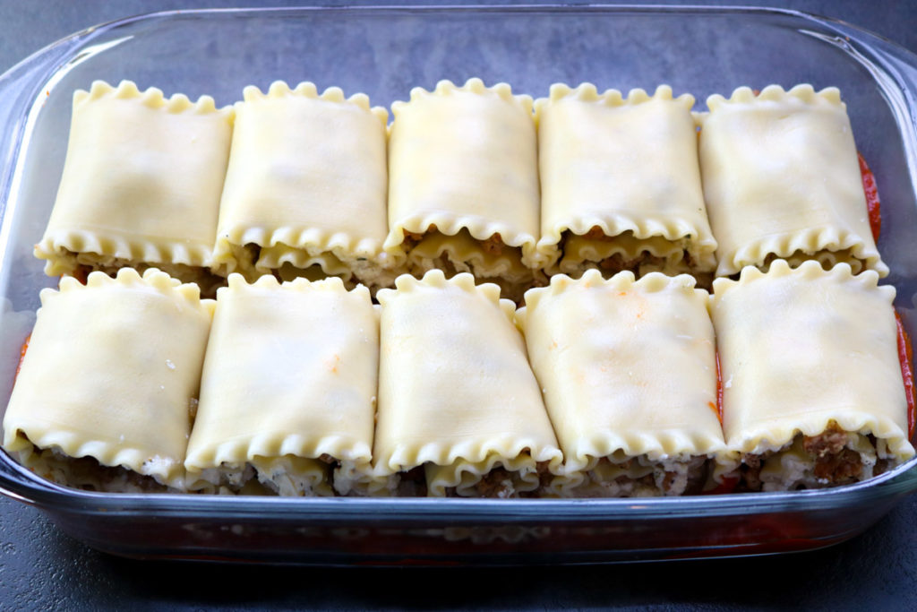 The lasagna roll ups in a glass baking pan, before the marinara is poured on top www.momsdinner.net