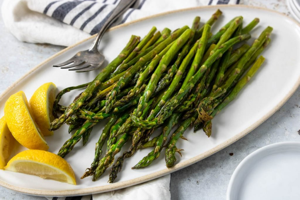 fresh cooked asparagus on a plate