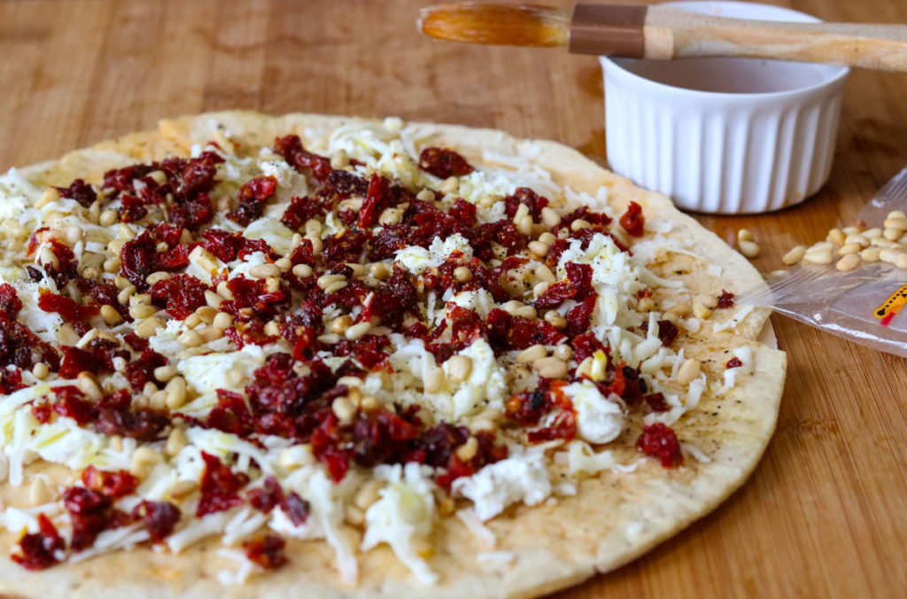 Goat Cheese Pizza with Sun Dried Tomatoes and Pine Nuts momsdinner.net