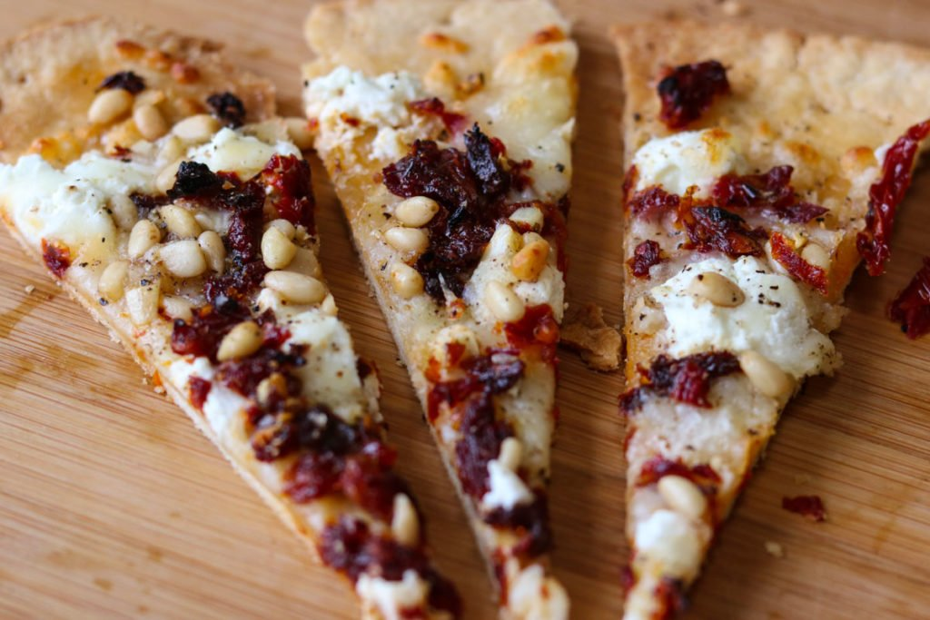 Goat Cheese Pizza with Sun Dried Tomatoes and Pine Nuts cut into appetizer size momsdinner.net