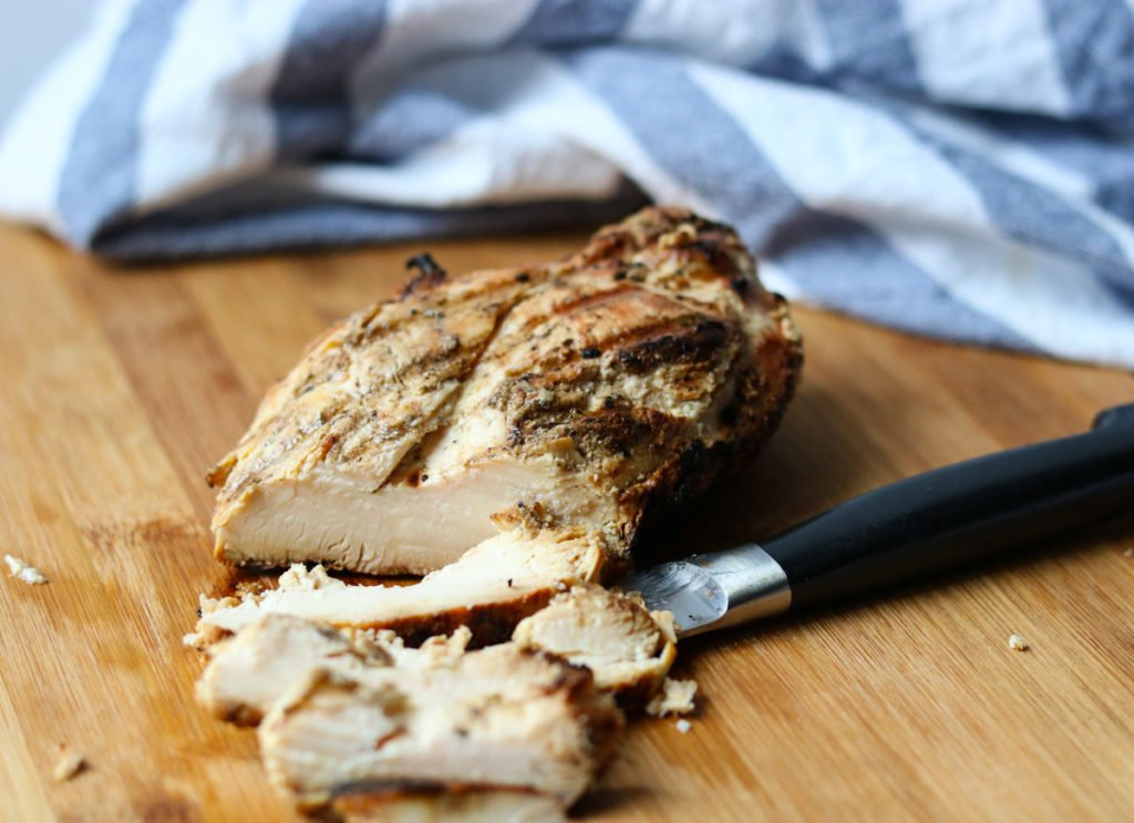grilled chicken breast cut into slices on a cutting board momsdinner.net