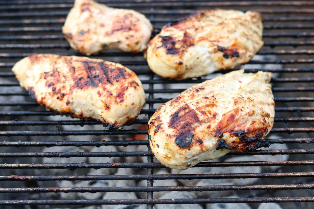 chicken breasts grilling on a charcoal grill momsdinner.net