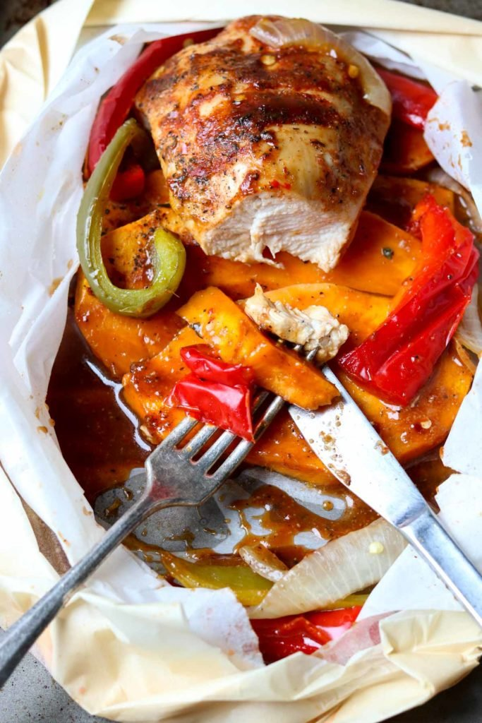 Barbecue Chicken in Parchment with Sweet Potatoes & Peppers with a bite taken out