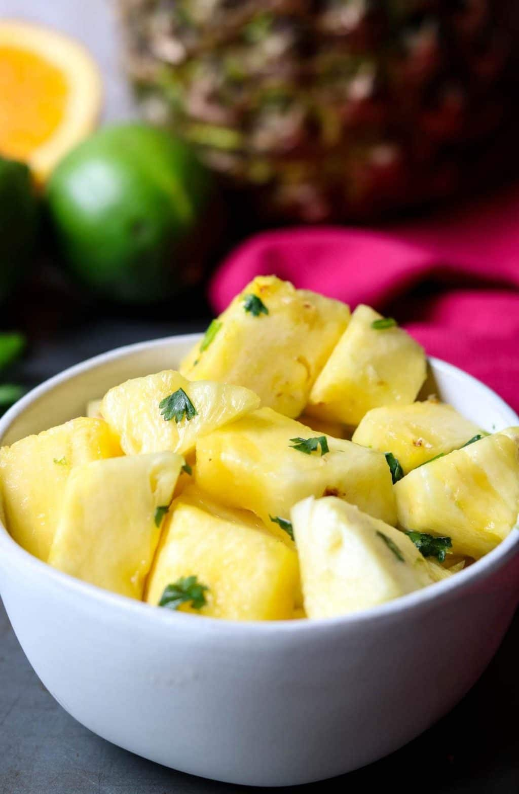 Citrus herb pineapple in a white bowl