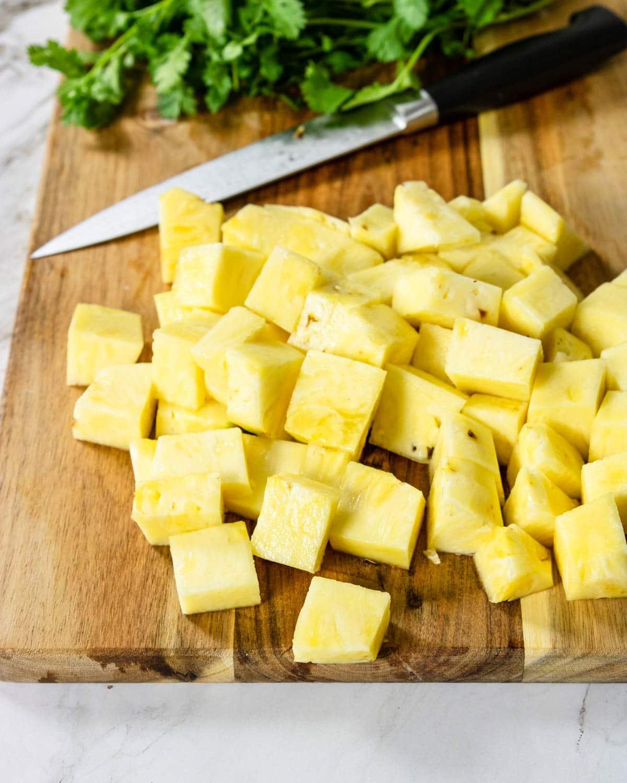 cut pineapple on a cutting board