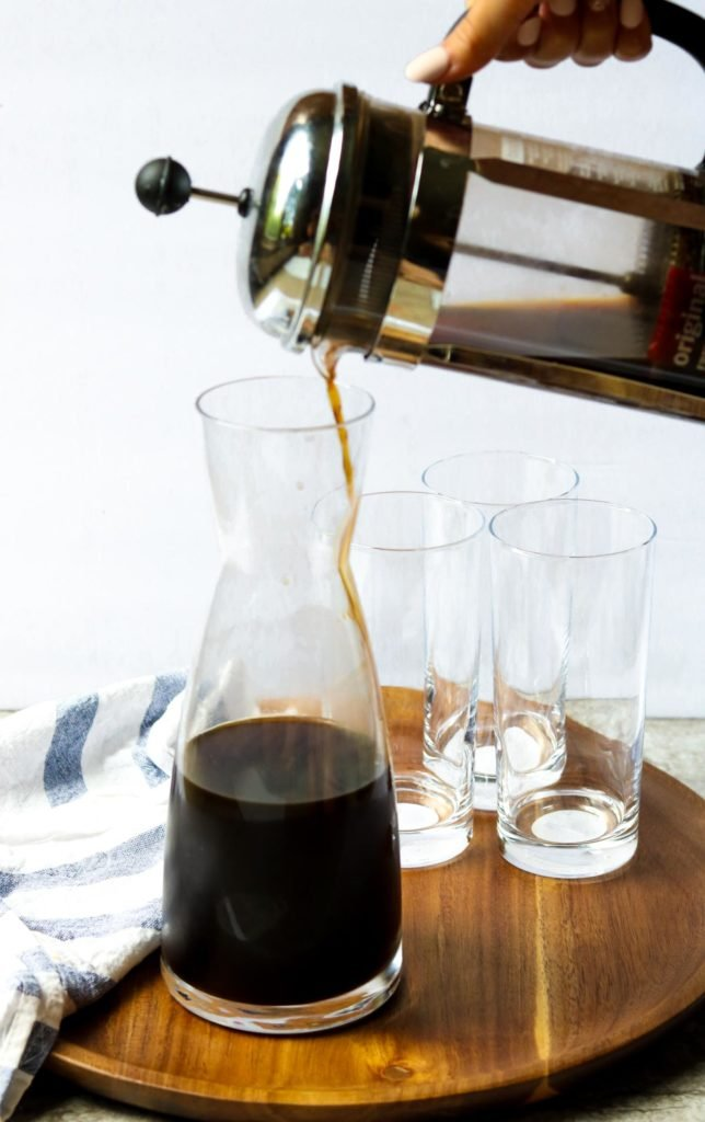 french press pouring coffee