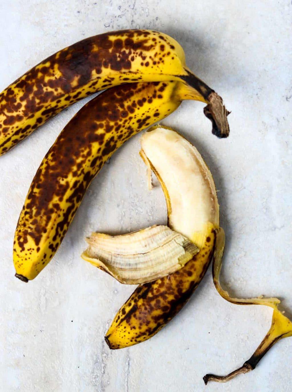 3 over-ripe bananas, one is half peeled