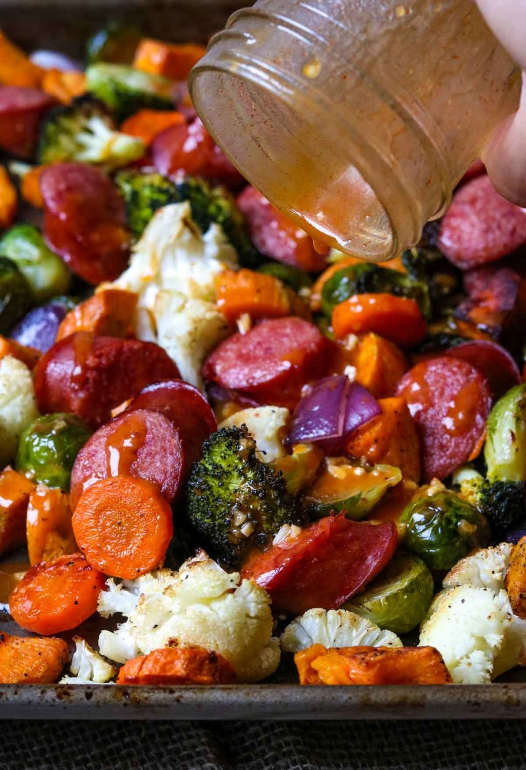 Smoked Sausage Sheet Pan Dinner with Veggies, and smoked paprika vinaigrette drizzled over top