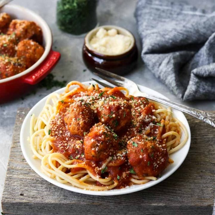 a plate of spaghetti topped with meatballs
