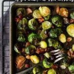 Oven Roasted Brussels Sprouts on a baking sheet with pinterest text overlay