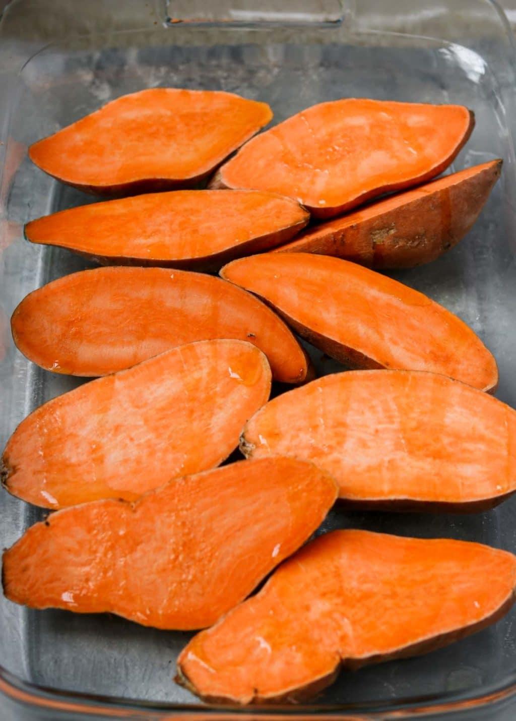 fresh cut sweet potatoes in a baking dish
