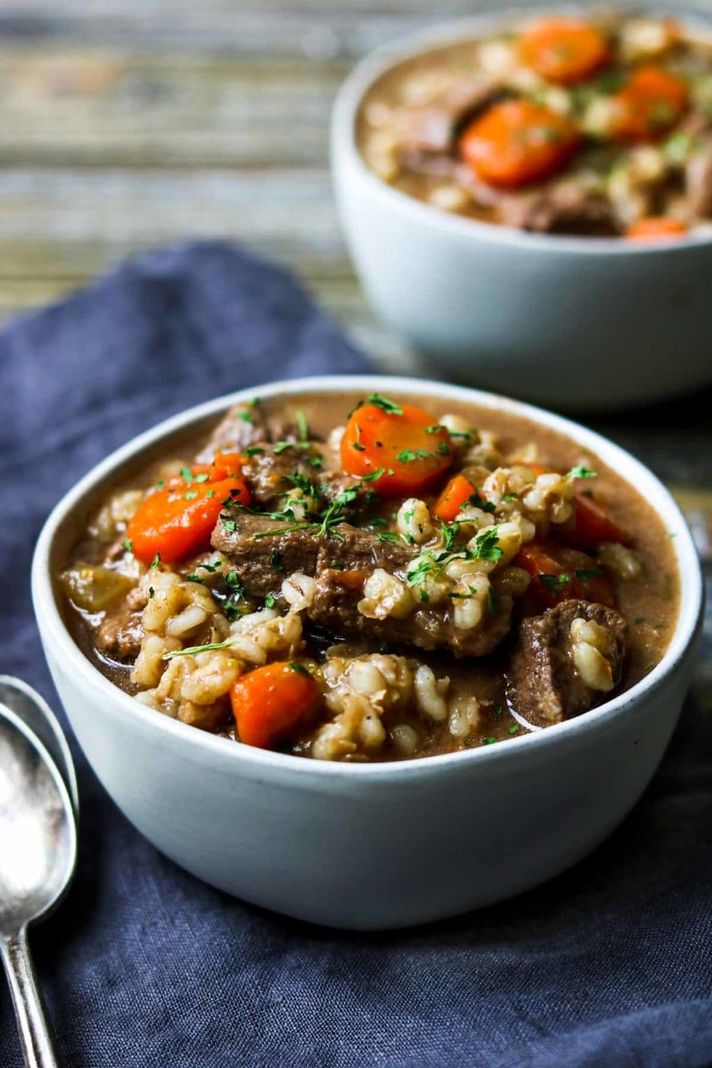 two bowls of beef and barley soup