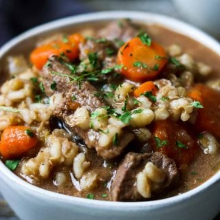 white bowl of beef and barley soup