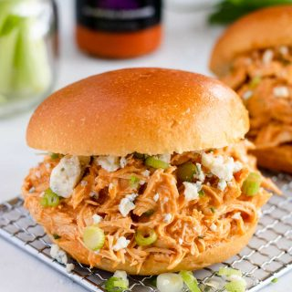 Buffalo Chicken Sandwiches topped with blue cheese crumbles and green onions