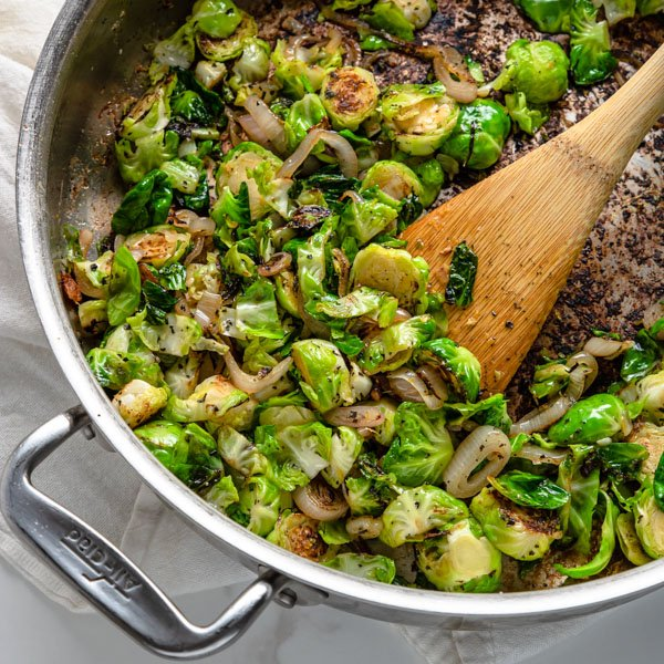 Brussels Sprouts and shallots sauteed and caramelized in a skillet