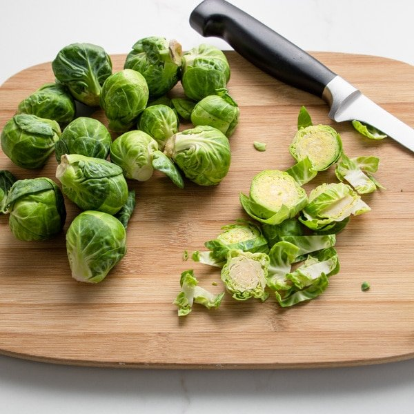 Brussels Sprouts on a cutting board, cut into slices