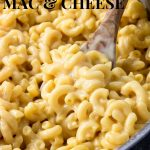 Close up of cheesy mac and cheese on a wooden spoon, pin image