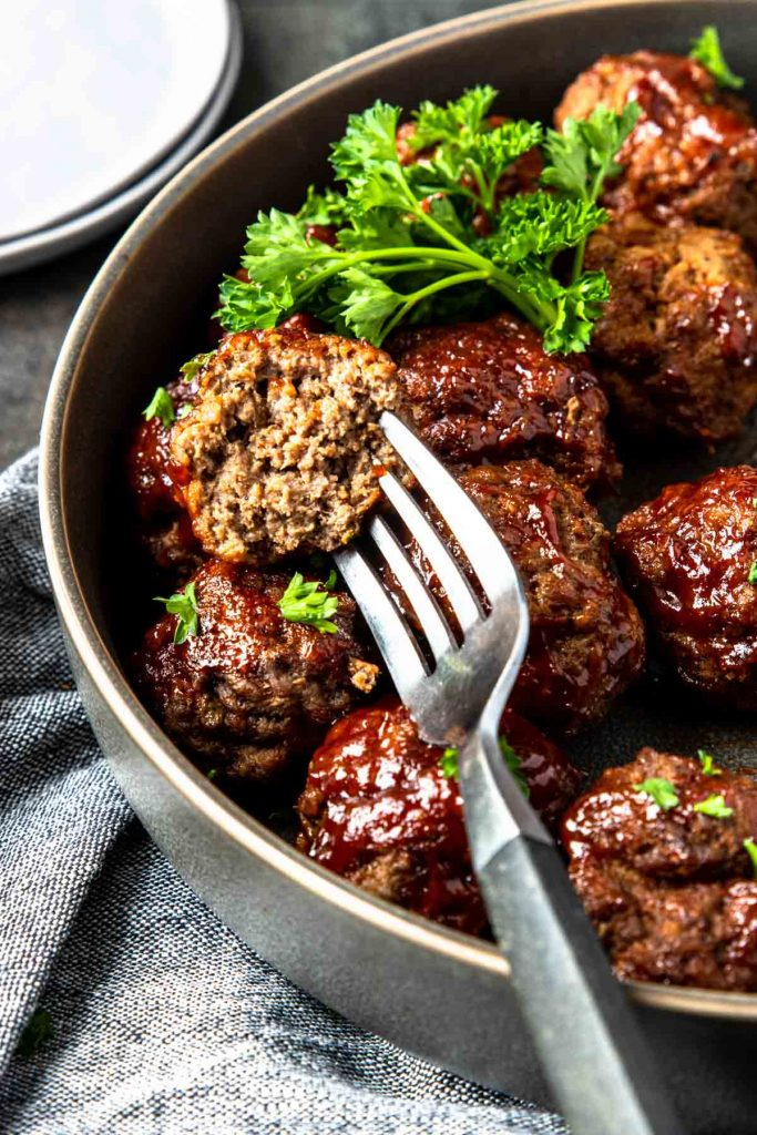Instant Pot Meatball cut in half and covered in BBQ sauce
