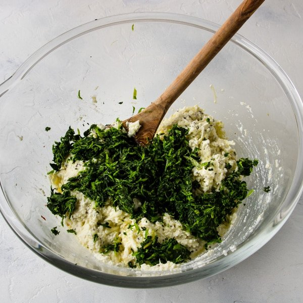 Step two -Thawed and drained Spinach added on top of the ricotta mixture for stuffed shells