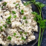 instant pot mushroom risotto garnished with parsley