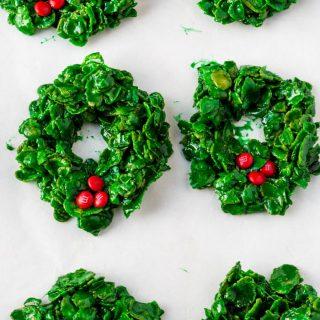 Green cornflake wreath cookies on a baking sheet