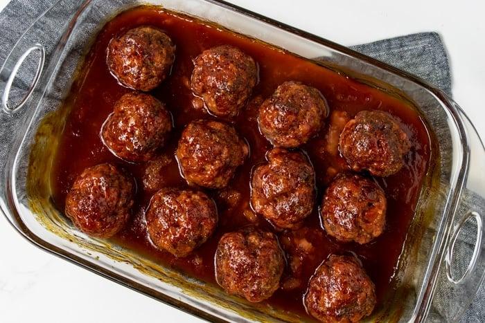 a 9x13 baking dish full of Iowa Ham Balls