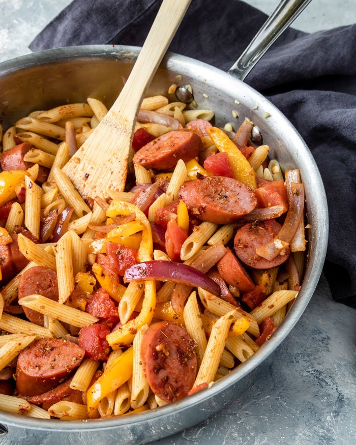 penne pasta, beef sausage, peppers and onions coated in cajun seasoning and spices