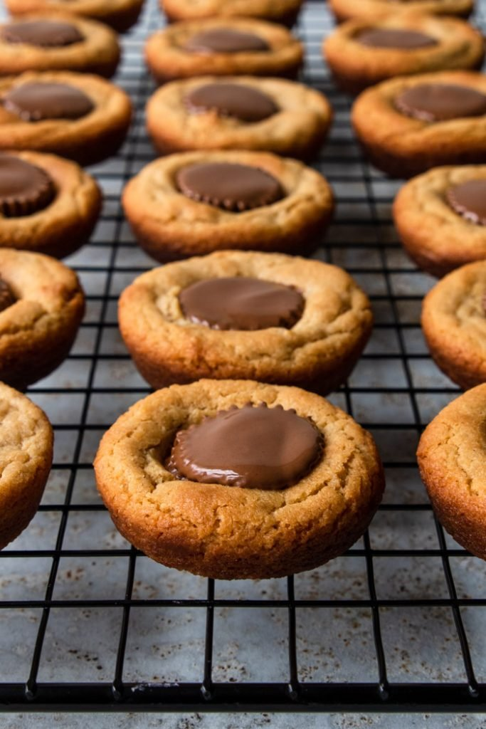 Reese's Peanut Butter Cup cookies cooling on a rack
