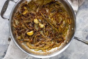 onions, garlic, and rosemary caramelized in a pan