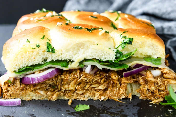 BBQ Chicken Sliders with red onions, cheese, and cilantro