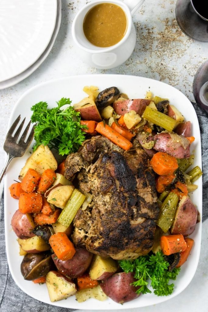 Instant Pot Pork Roast with Vegetables and Gravy on a white platter
