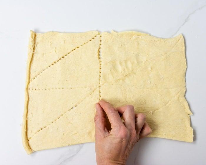 closing the seams of crescent dough