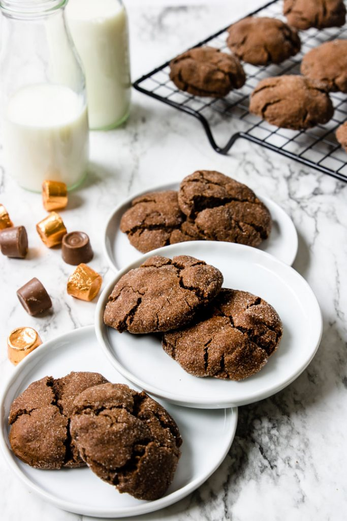 Chocolate Rolo Cookies on white plates and on a cooling rack