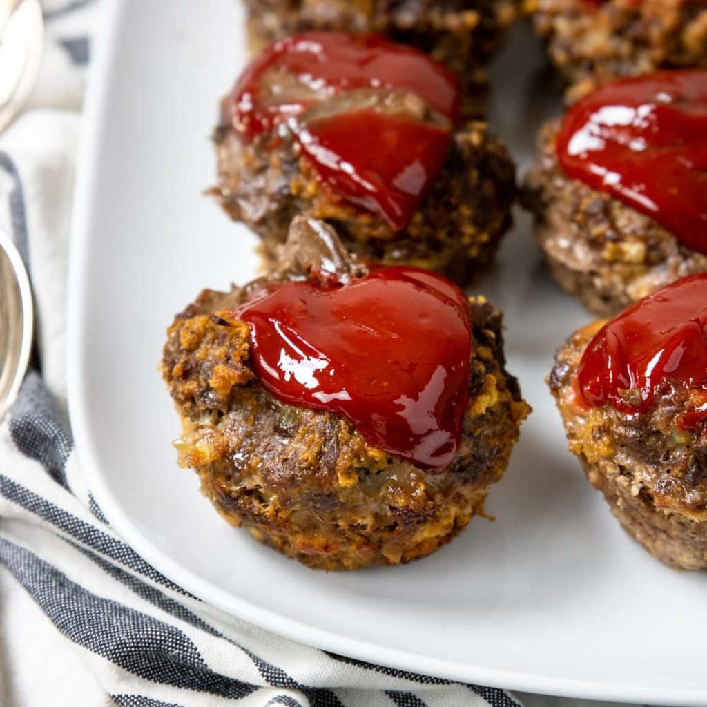 Meatloaf muffin topped with ketchup