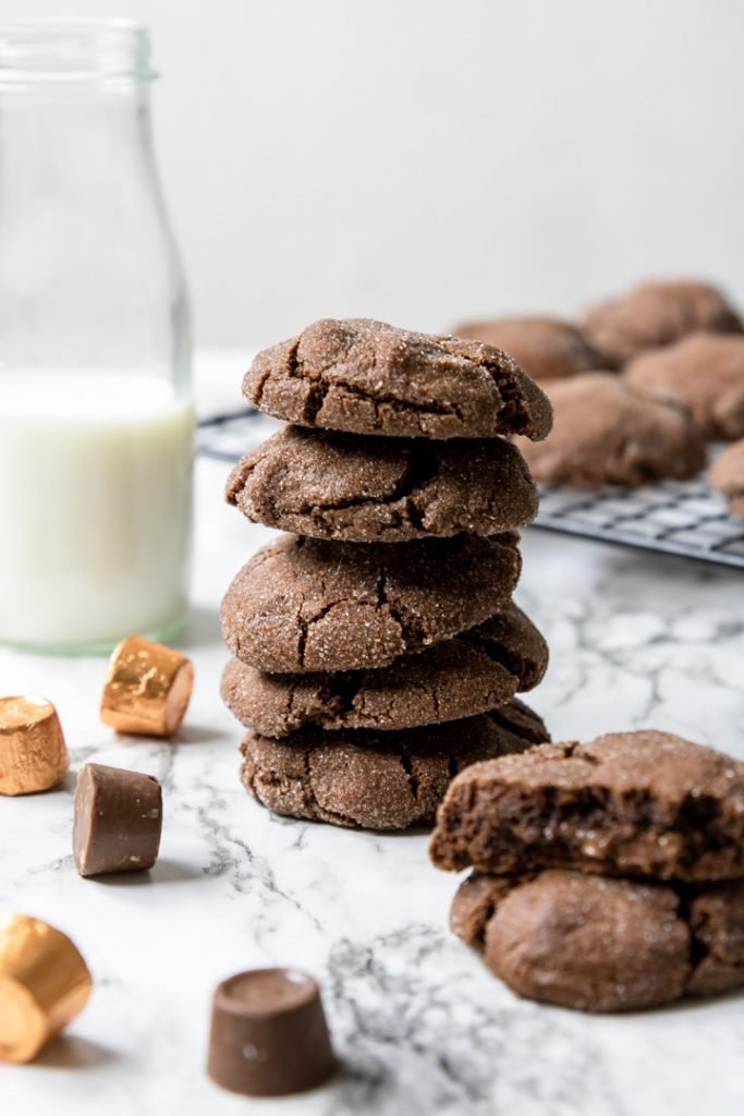Rolo Cookies in a stack with a bottle of milk to the side