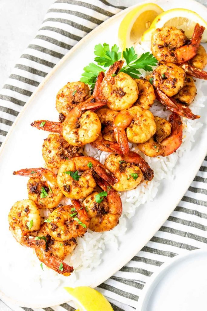 Skillet Cajun Shrimp served on a plate over white rice