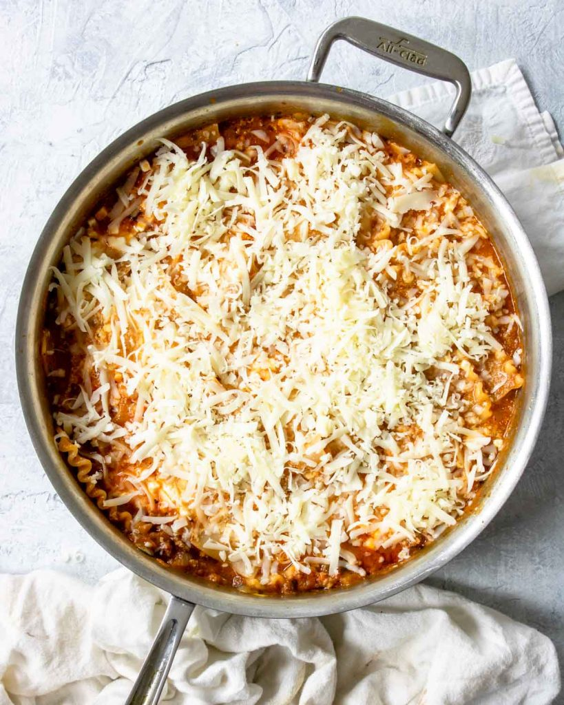 how to make skillet lasagna - step 3, topping the lasagna with shredded mozzarella