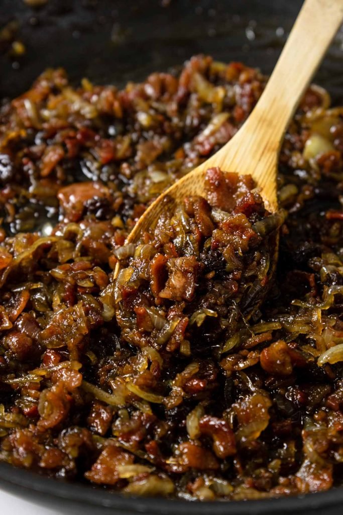 bacon jam on a wooden spoon