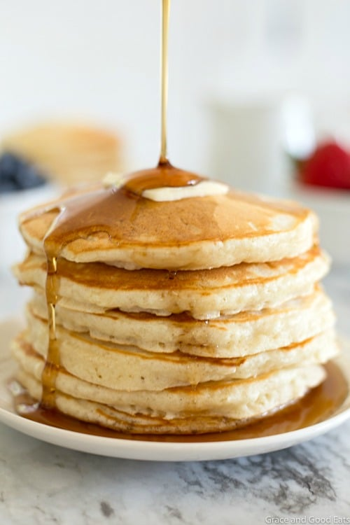 stack of pancakes with syrup drizzle
