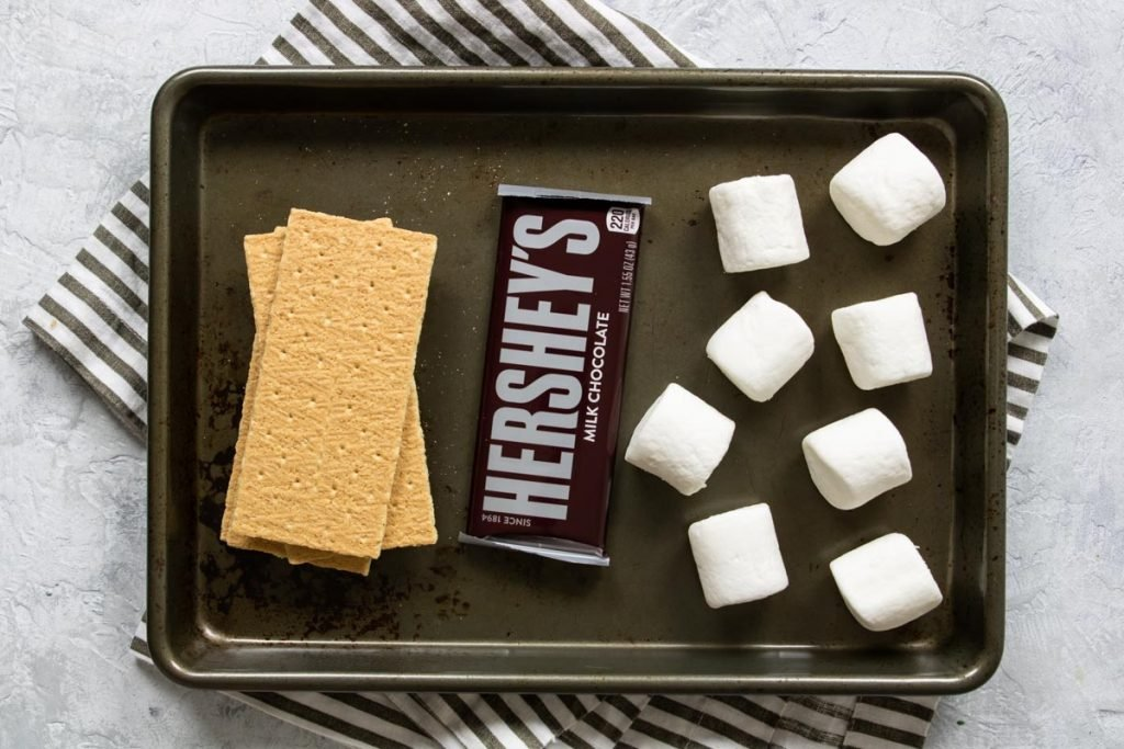 all the supplies for oven s'mores - graham crackers, chocolate bar, marshmallows
