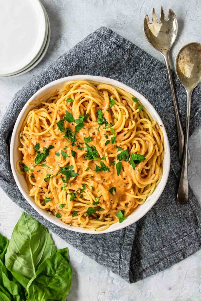 A bowl of pasta with tomato cream sauce