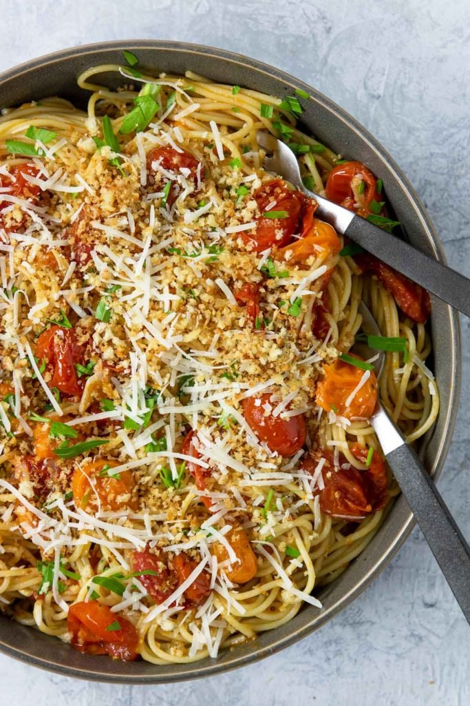Pasta tossed with pan roasted tomatoes and topped with toasted bread crumbs and parm cheese