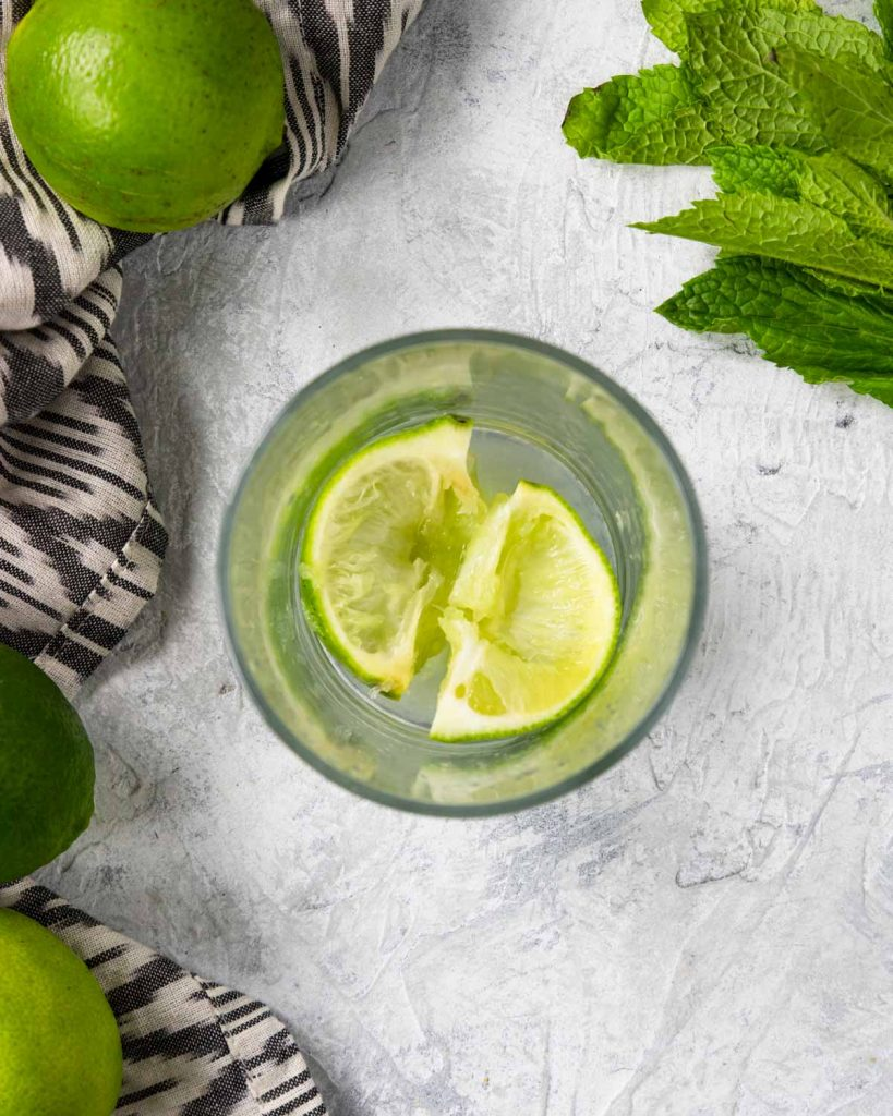 lime muddled in a glass
